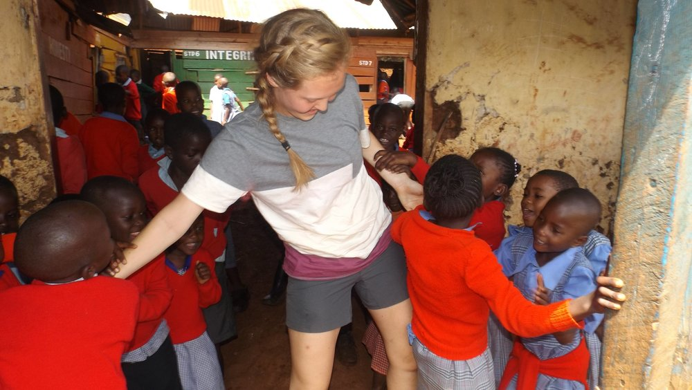 Joanna at school caught in the middle of a tug-of-war...over her. The prize for the winners Having this Cornell University double major in 'Biology and Society' and 'International Agriculture and Rural Development' teach your class!