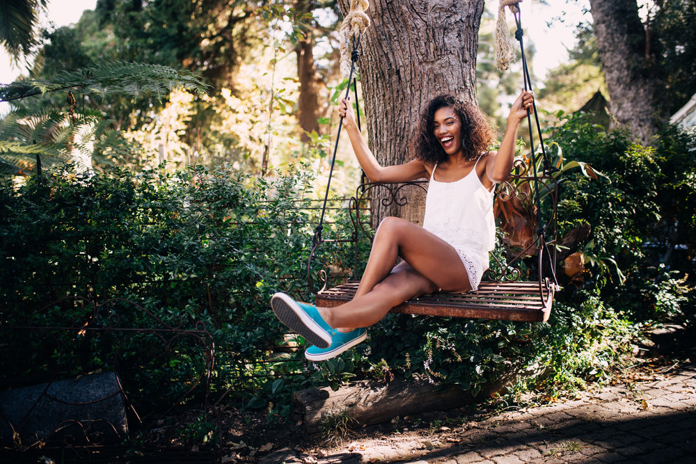 garden-summer-fun-swing-smile-woman-happy-mixed-race-afro-american-outdoor-living-space_t20_XQLr03.jpg