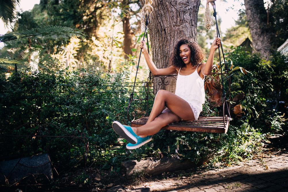 garden-summer-fun-swing-smile-woman-happy-mixed-race-afro-american-outdoor-living-space_t20_XQLr03.jpg