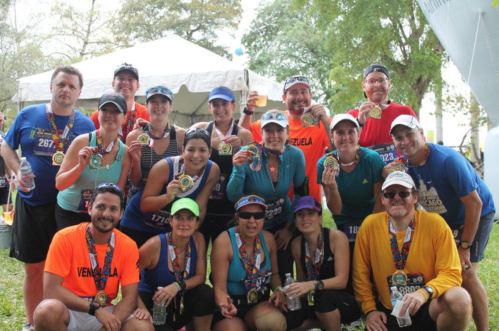 From left to right: Top Row: Peter McGrath (2:37:18); Jose Herrera (1:58:04); Belen Bradley (2:04:03); Luli Garcia (2:33:47); Osvaldo Garcia (2:59:54); Jose Salgueiro (2:17:25). Middle Row: Jennifer McGrath (2:26:03); Maria C Pernalete (2:55:41); Lupe Bradley (2:19:44); Maria Salgueiro-Alessio (2:41:26); Lionel Alessio (2:41:26). Bottom Row: Franz Pernalete (2:25:54); Marisol Garcia (2:56:50); Neycy Morales (2:33:28); Marianela Garcia (2:40:02); Adolfo Salgueiro (2:49:05). Not shown: Christina Bradley (3:00:11); Maria Inés Garcia (3:35:48).