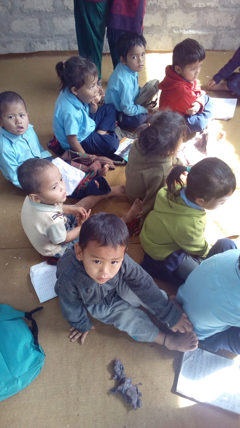 Young students use the temporary learning center after the volunteer team supported the construction.