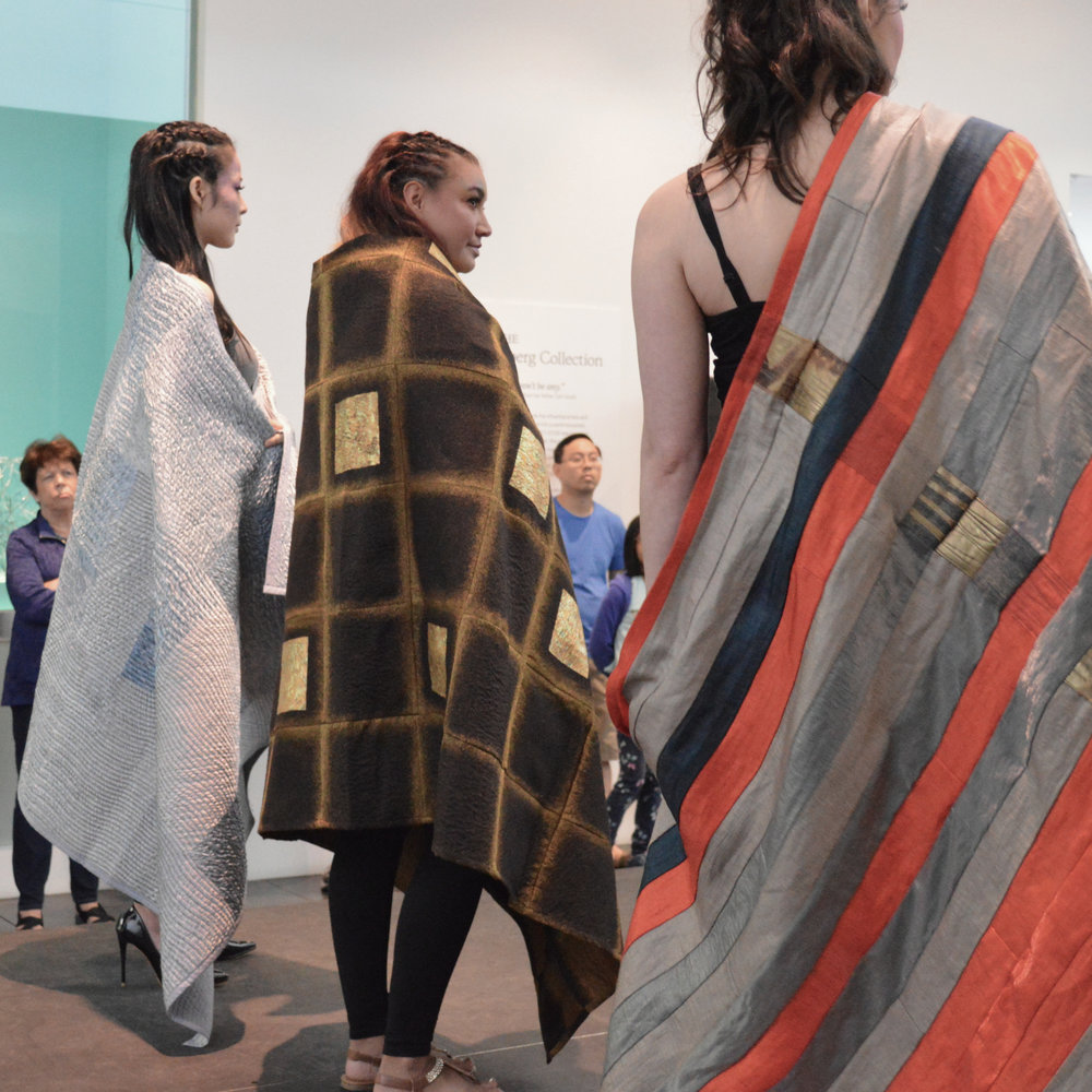 Three blankets on the runway by Britt Rynearson at the Tacoma Art Museum's 2018 Northwest Native Festival