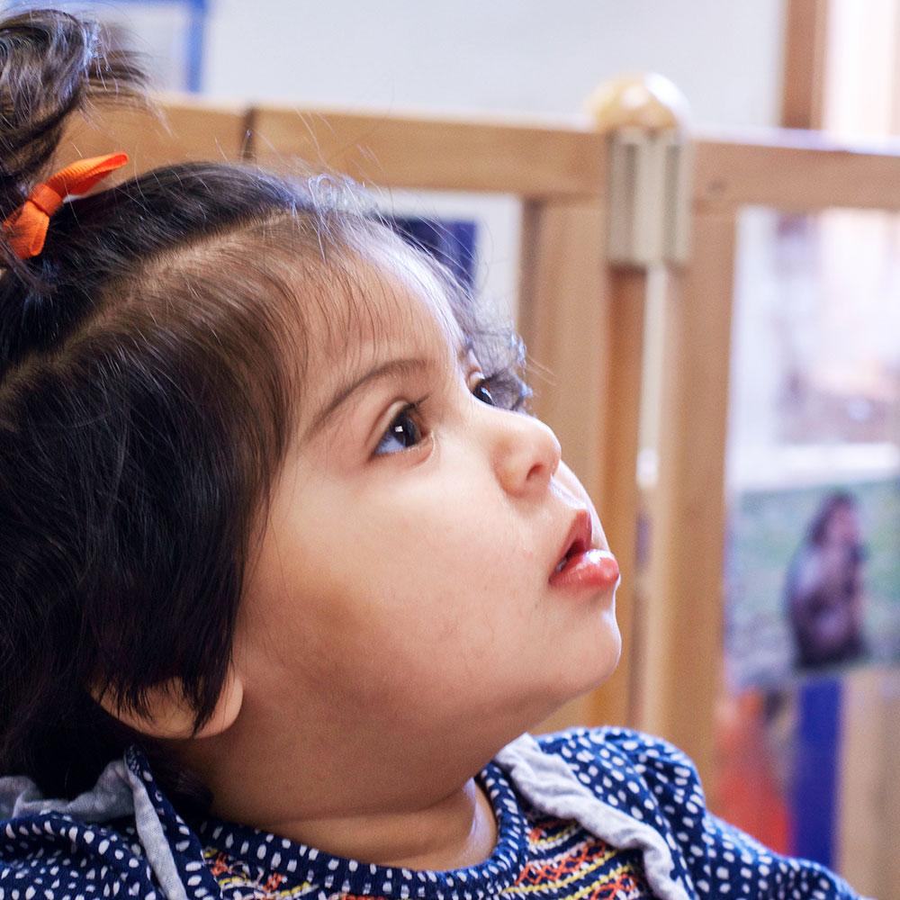 toddler-listening-to-carer.jpg