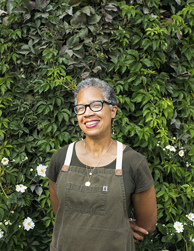 """DONNA MOODIE - DONNA MOODIE opened her first restaurant, Marco's Supper Club, in Belltown in 2003 and relocated to Capitol Hill in 2011 where she opened Marjorie's, named after her mother. Growing up in Jamaica and cooking with her mother, she quickly gained respect for """"scratch"""" cooking, using ingredients supplied by local farmers and merchants whenever possible. In 2015 she introduced her mother's famous plantains to the commercial market. Called Miss Marjorie's Steel Drum Plantains, they are sold in select grocery stores and small markets in Seattle and across the US."""