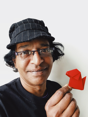 """LESLIE THYAGARAJAN - LESLIE THYAGARAJANI is an artist who has been creating, performing, and teaching special styles of artworks in virtually all mediums. He learned magic from East Indian snake charmers and a British trickster and mixes both east and west in his teaching and performing. His talents include Origami, Puppetry, Cartooning, 3D, plus his original invention of the art of """"Filterism"""". His film, Magic Verite, is popular among all ages."""