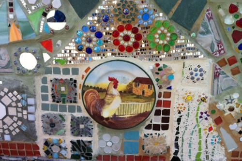 GOODWILL MOSAIC | 2014 - Mosaic narrative on a planter at Seattle GoodwillPartner: GoodwillTeaching Artist: Karen Stocker