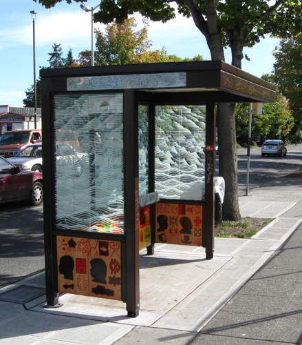 BUS SHELTERS | 2009 - Location: 23rd & Union // Partner: Starbucks & King County Metro // Panels on two bus shelters honor the diversity and social history of the Central Area through silhouettes of the Hit the Streets participants and abstractions of symbols that have cultural significance for them // Teaching artists: Romson Bustillo, Michael Lawson, Brent McDonald