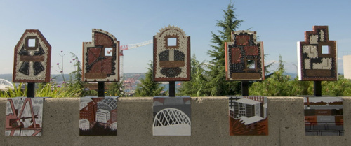 VIEWFINDERS | 2008 - Location: Harborview Medical Center // Partner: First Hill Community Council // Twenty-three viewfinders line a concrete wall at View Park across from Harborview Medical Center on First Hill. Viewers look through them to discover iconic sites of the Seattle cityscape which are abstracted below in enamel paint // Teaching artists: Liza vonRosenstiel, Mark Fessler, Brent McDonald, Angelena McQuarter