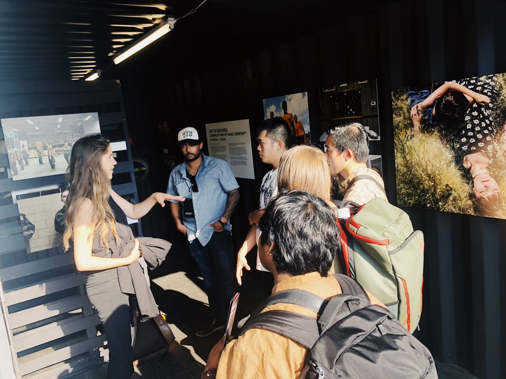 2017 Fellows Sarah Blesener and Brian L. Frank discuss their fellowship projects with incoming ICP students at Photoville.