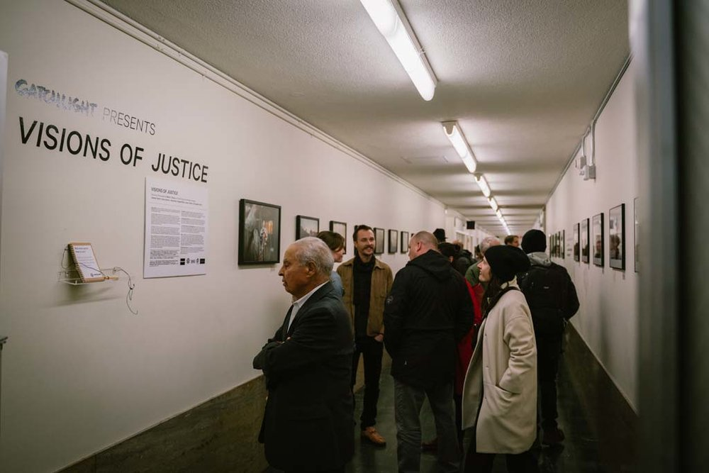 Guests check out the Visions of Justice exhibition at the Hall of Justice. Over 80 people came out to the opening of the exhibit and it will be on view through April 1, 2019.