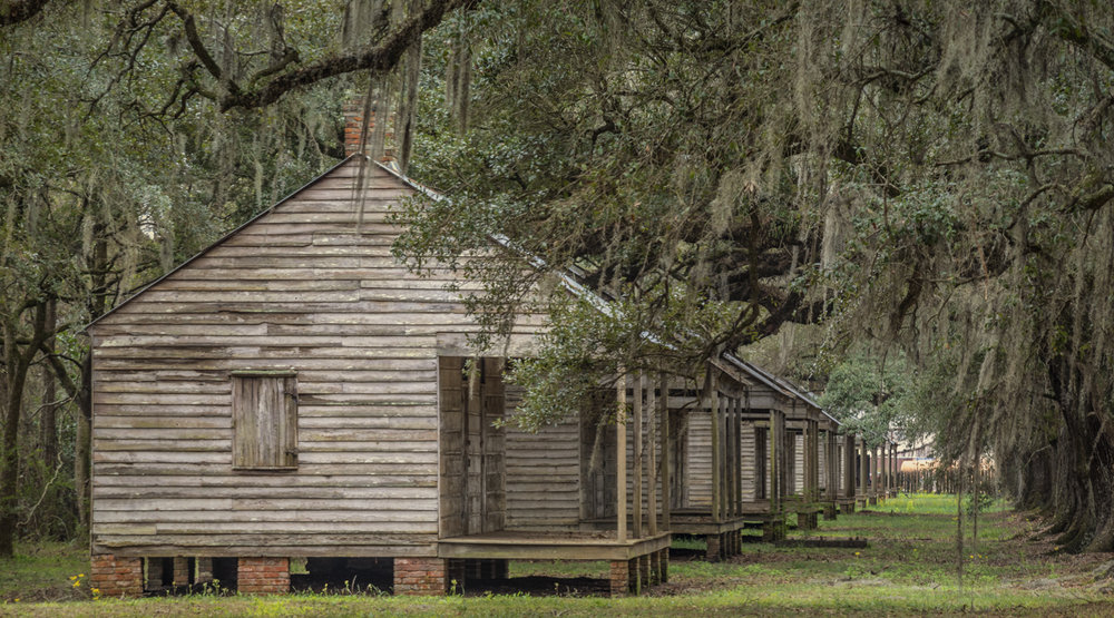 Click this photo to view the History of the Slave Village