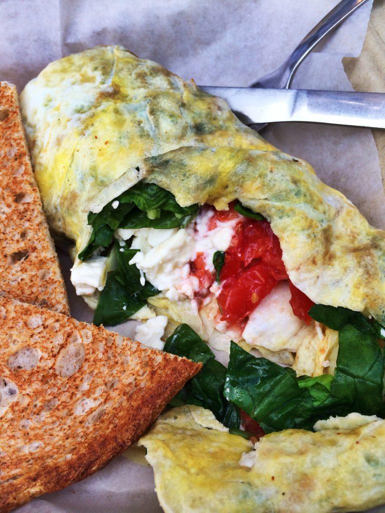 "The savory ""Ostara"" omelette- artichoke hearts, feta cheese, spinach, and tomatoes."
