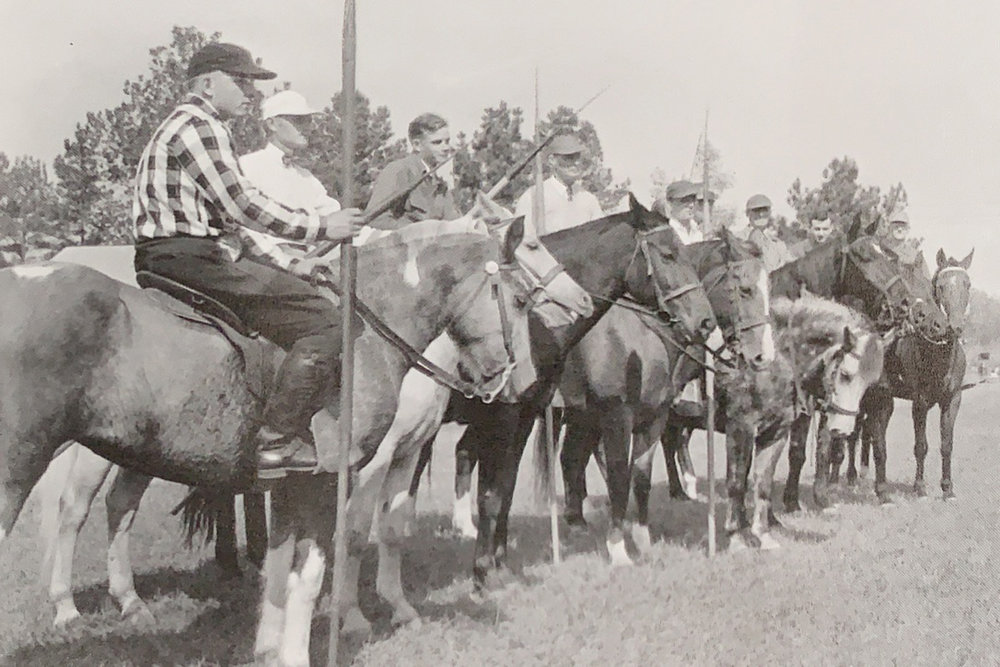 At the 1952 tri-centennial celebration, horsemen line up for the tilting tournament. Tilting, otherwise known as riding at the rings or ring spearing, is a form of jousting in which the horseman rides at full gallop and inserts his lance through small metal rings.