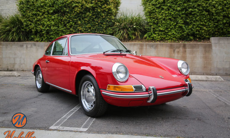 1969-porsche-911t-red-makellos-classics-passenger-side-view.jpeg