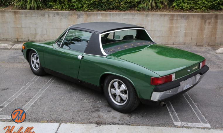 1970-porsche-914-6-green-makellos-classics-drivers-side-rear-angle-exterior-view.jpg