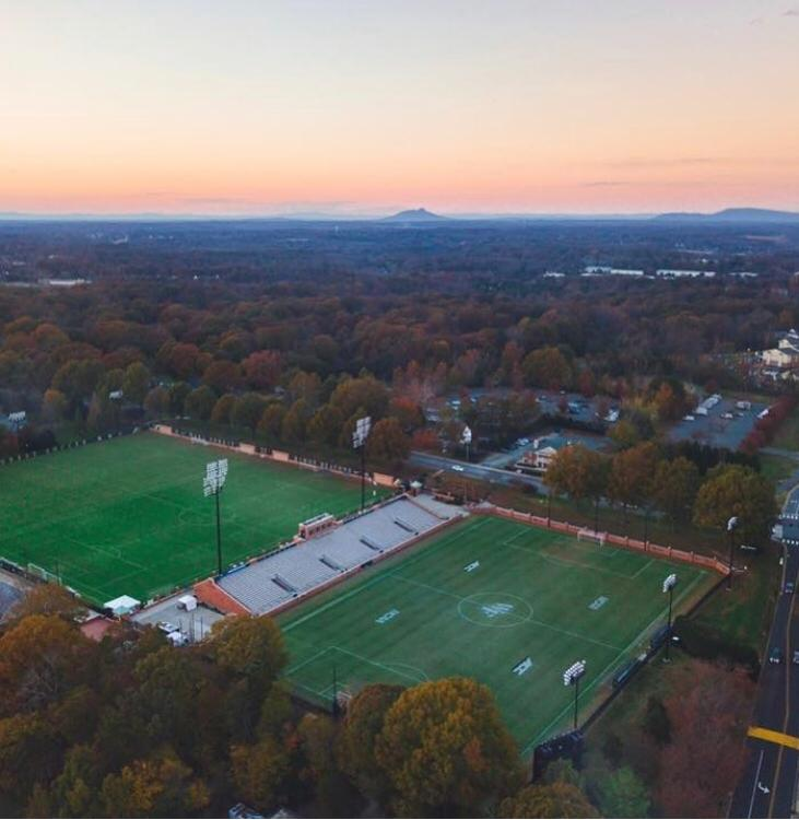 training facilities - On campus training facilities include two-full size, natural grass, lighted playing fields adjacent to the stadium and a short walk from both housing and dining facilities. Indoor turf training facilities are also available to the Campers.