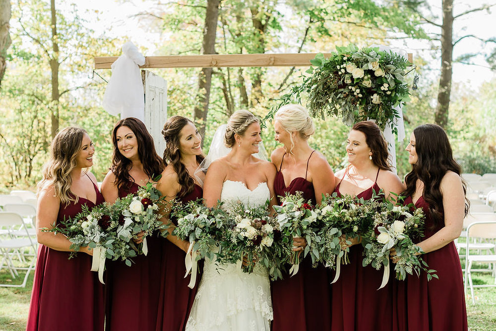 Bridal party wedding photography green orchard