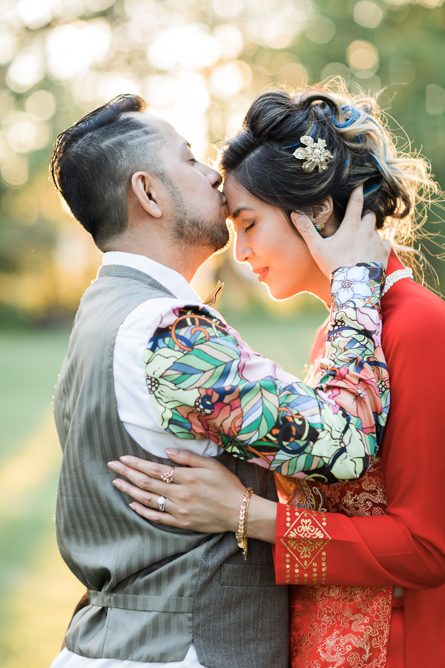 Bride and groom colourful couple red wedding dress green orchard wedding