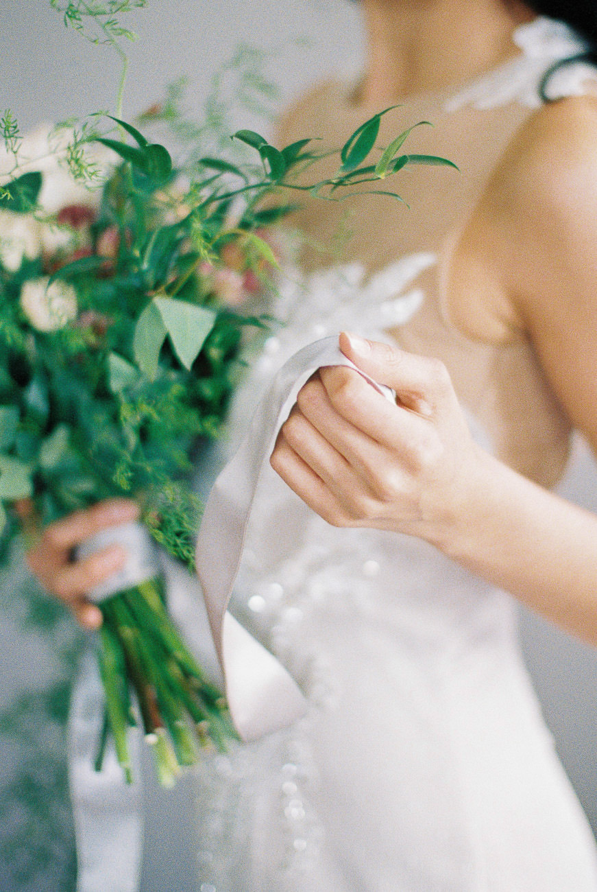 Bridal gown and bouquet detail green orchard wedding