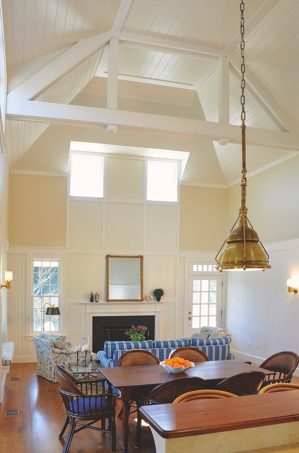 Modern_Farmhouse_Vaulted_Ceilings_Exposed_Beams_Brass_Chandelier_Pendant_Light_Lving_Room.jpg