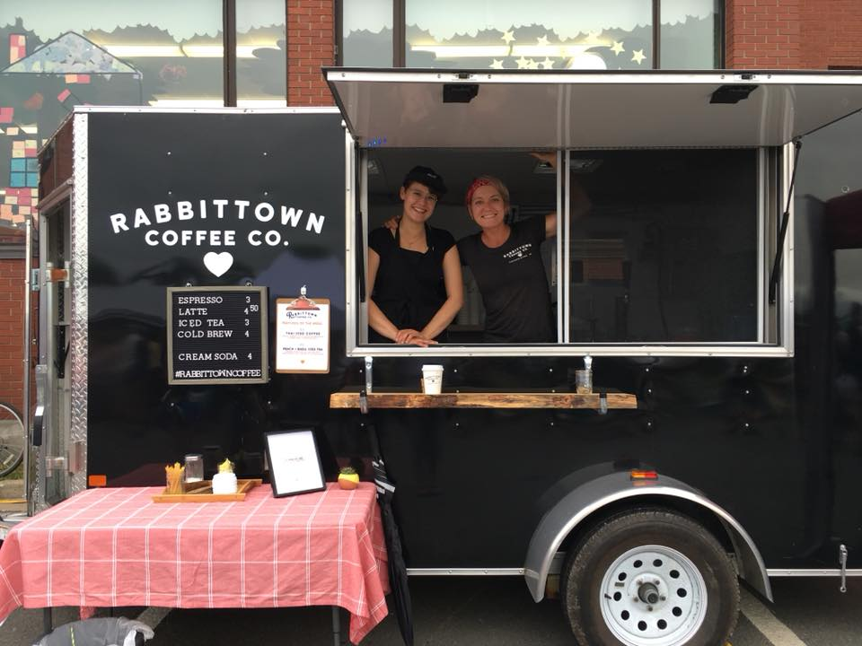 Katie Cunningham (Left) and Stef Loukes set up at the Garrison Night Market