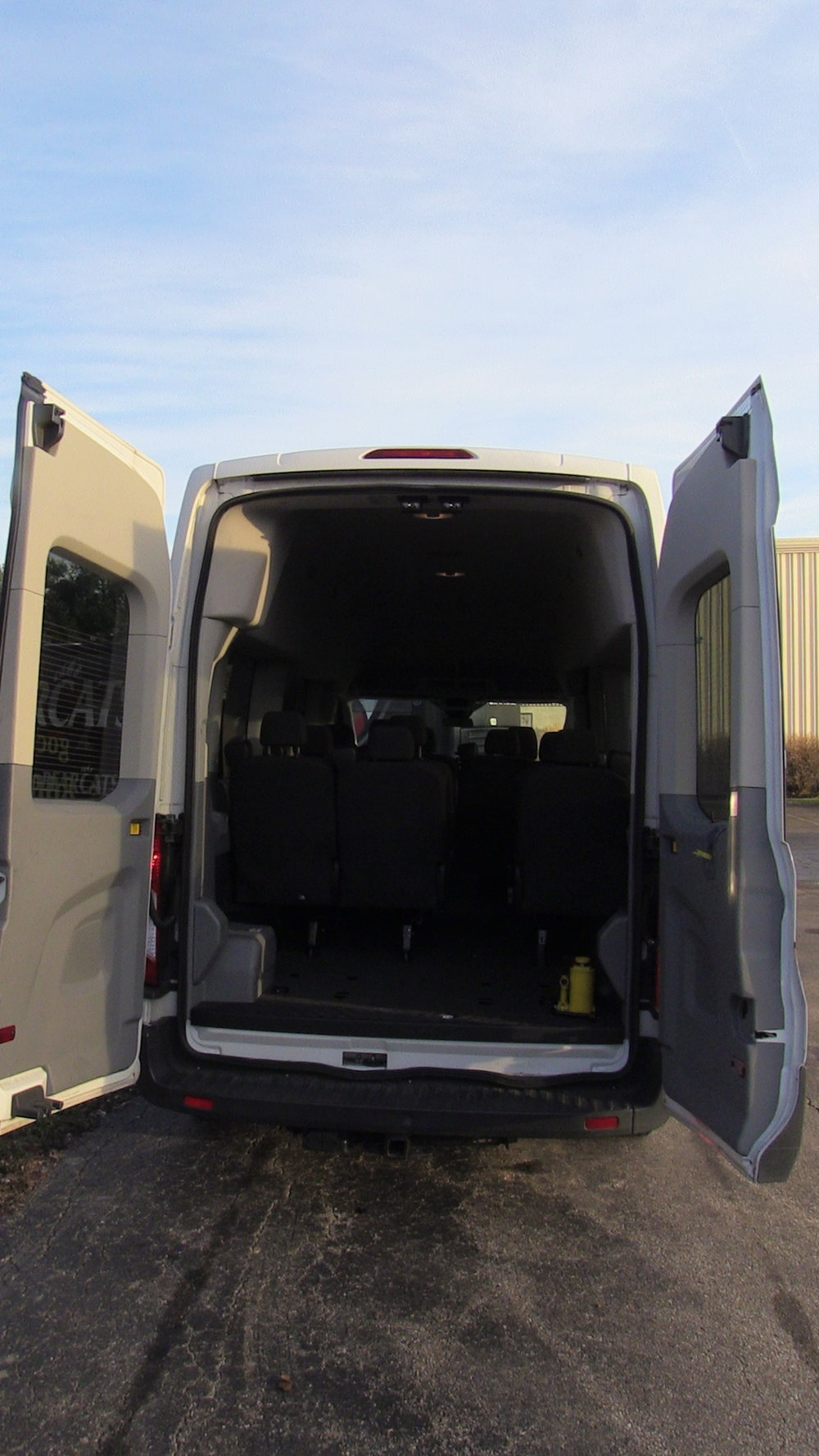 White Shuttle Rear Doors Open.JPG