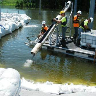 Application of AquaBlok to protect against rising floodwaters. Used with sandbags to form a reliable seal.