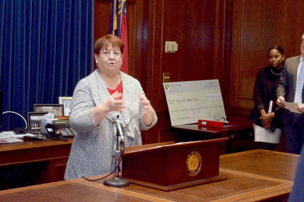 Gwinnett County Commission Chairwoman Charlotte Nash addresses attendees at the announcing of Hapag-Lloyd's expansion earlier this week in Gov. Nathan Deal's ceremonial office. (Staff Photo: Curt Yeomans)