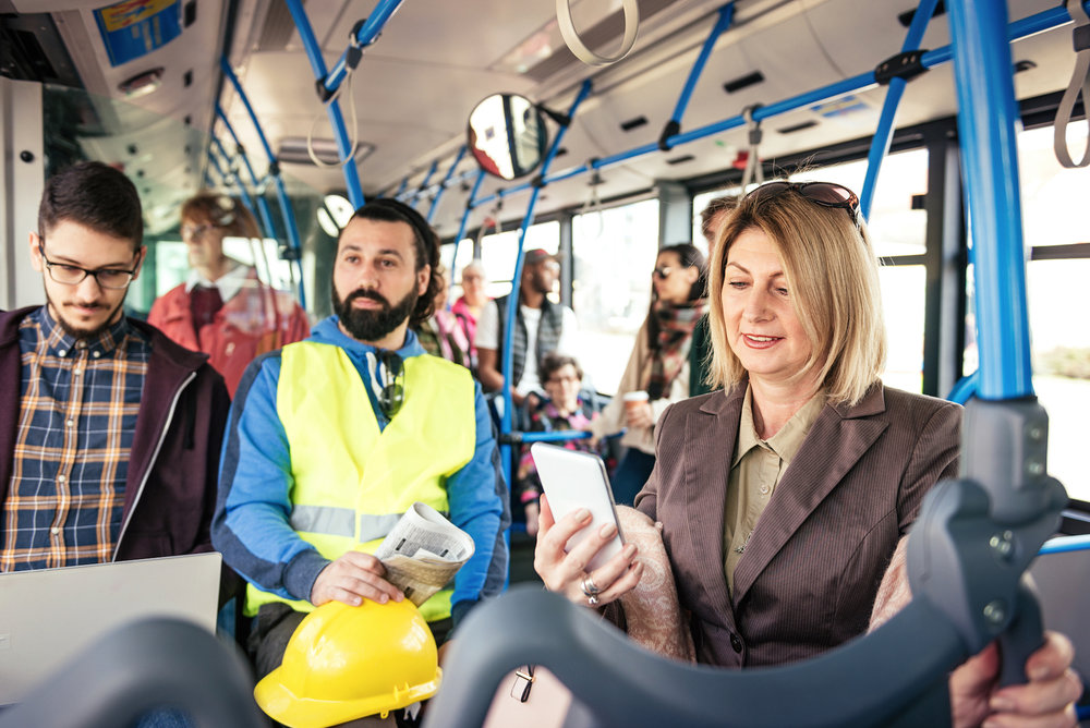 Casual-business-people-traveling-by-public-transportation-938280904_7360x4912.jpeg