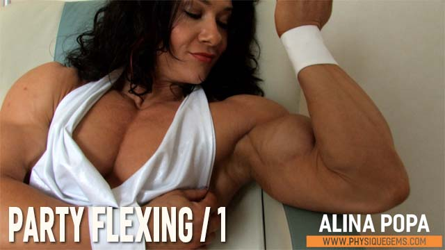 Party Flexing part 1 - Alina's muscle on fantastic display as she lounges in the chair, wearing a revealing white club dress. [3:56]