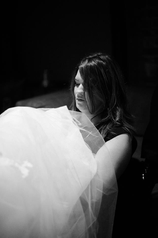 Me working on Erin's Dress Bustle on her wedding day. Photo by    Britta Marie Photography   .