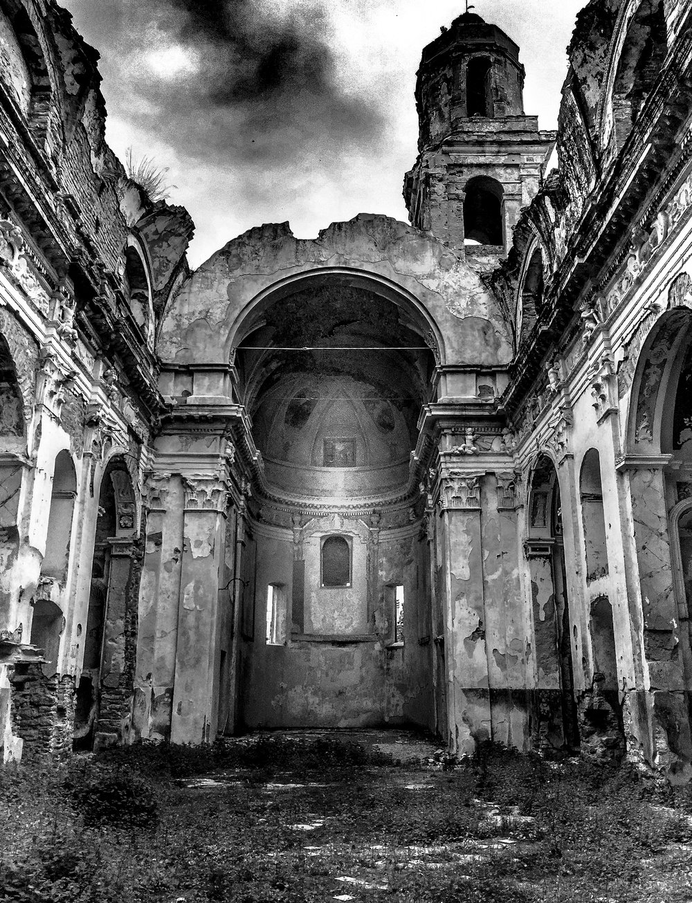 Destroyed Church in the province of Liguria, Italy. Refugees camp on the ground in this ruined church near the Italian-French border.