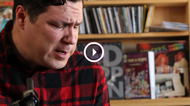 The play button here is a lie. But, if you click it, you will be presented with an actual play button that is not a lie. So, click it now. You will be rewarded with  Damien Jurado's Tiny Desk Concert on NPR .
