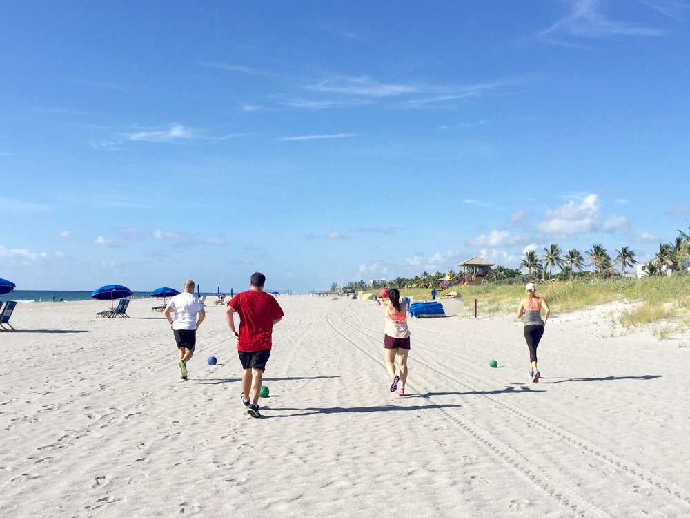 Medicine ball class at the beach.