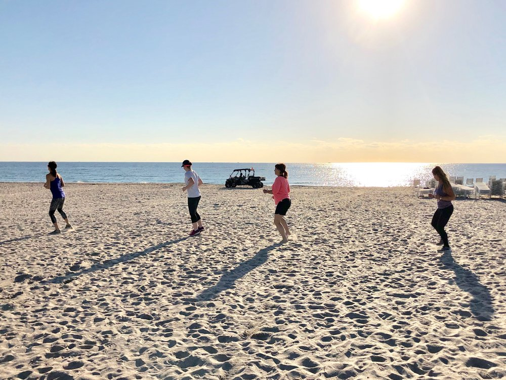 Guests working out on the beach during their retreat.