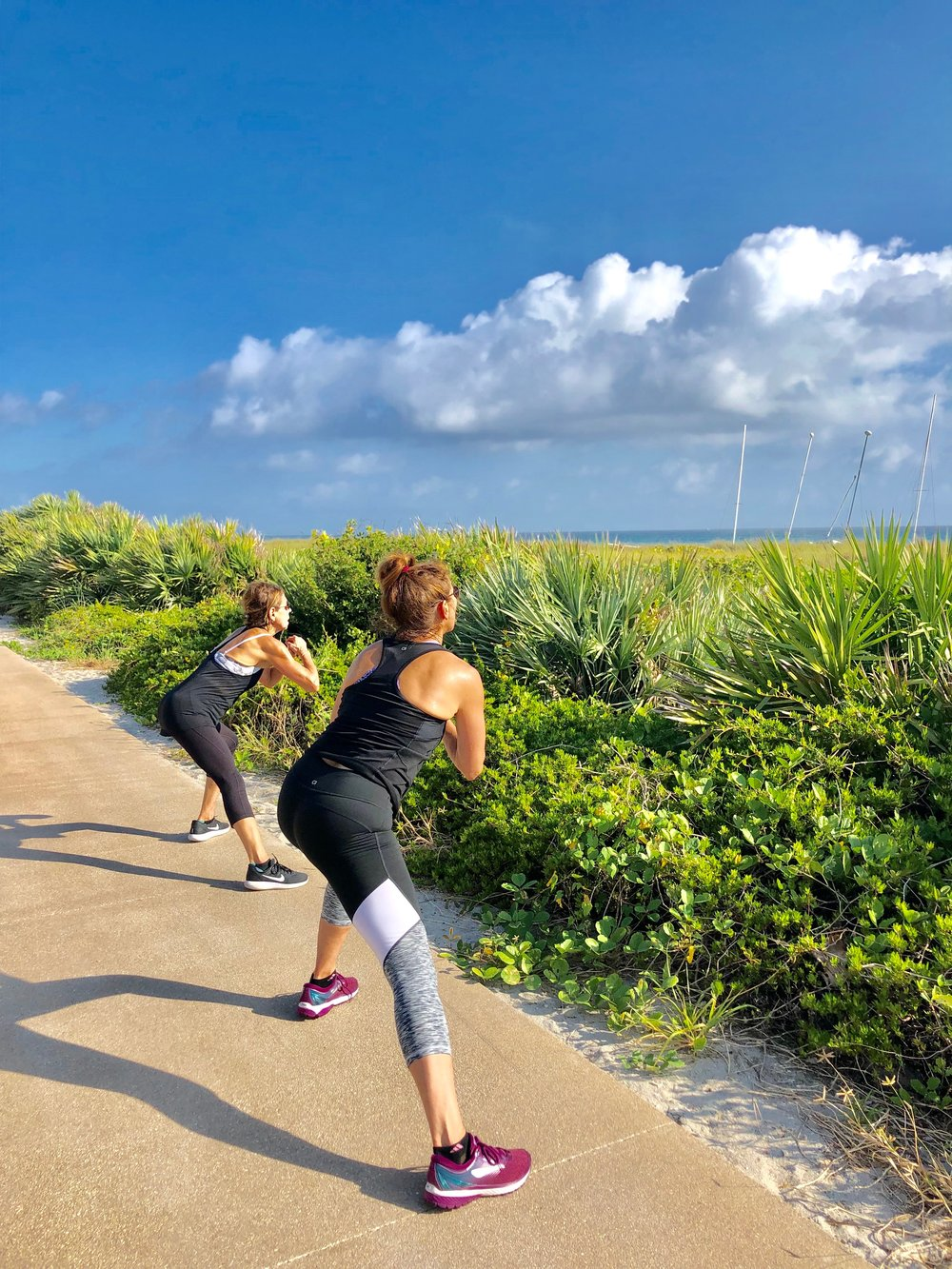 Ladies working out to jumpstart their weight loss during the morning beach session.