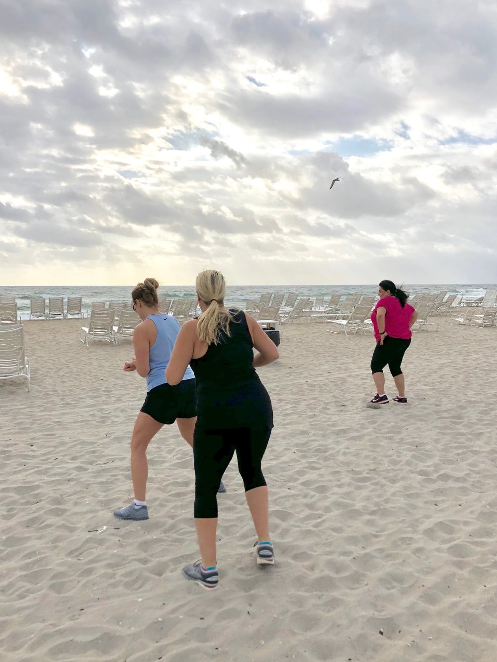 Guests enjoy another workout on the beach.
