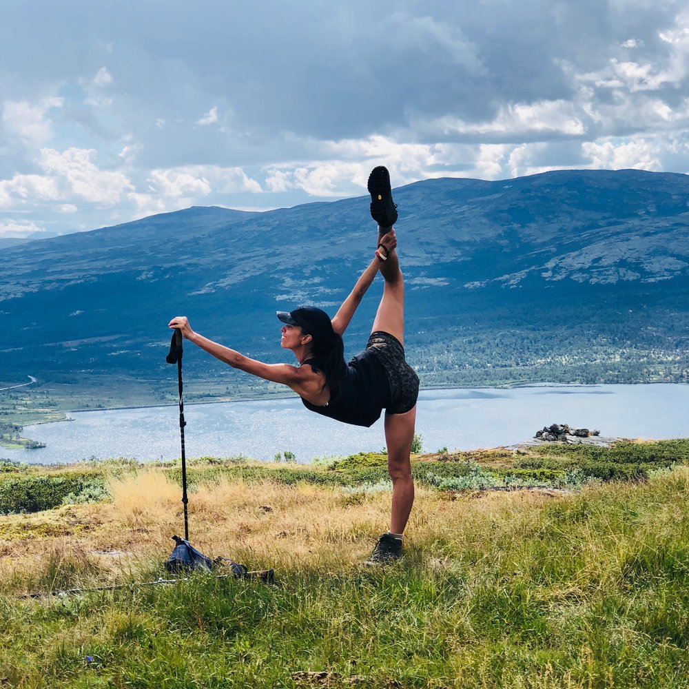 CHRISTINE THOMAS, A PILATES AND DANCE TEACHER, SHOWING HER STRENGTH IN A BALANCE POSE.