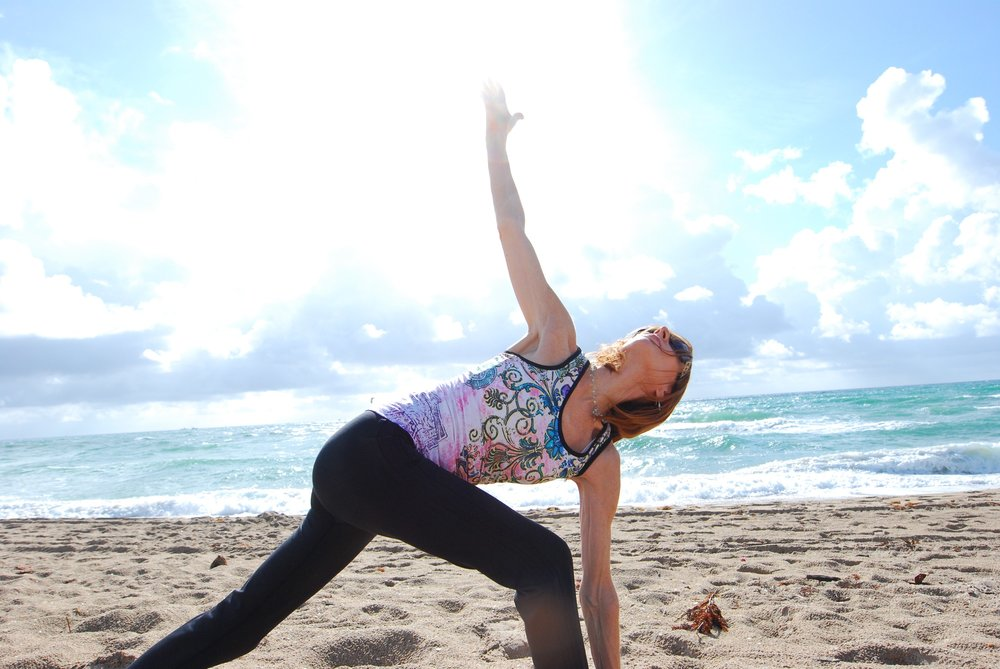 Woman enjoying her stretch sessions during private fitness retreat.