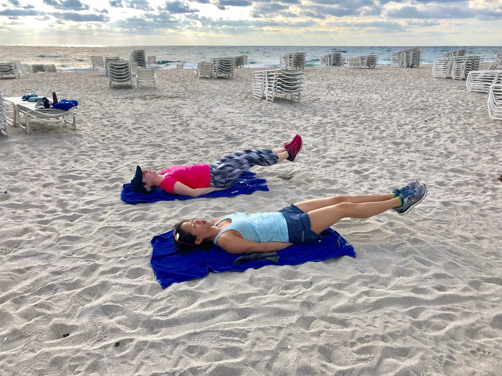 Boot camp guests do core workout.