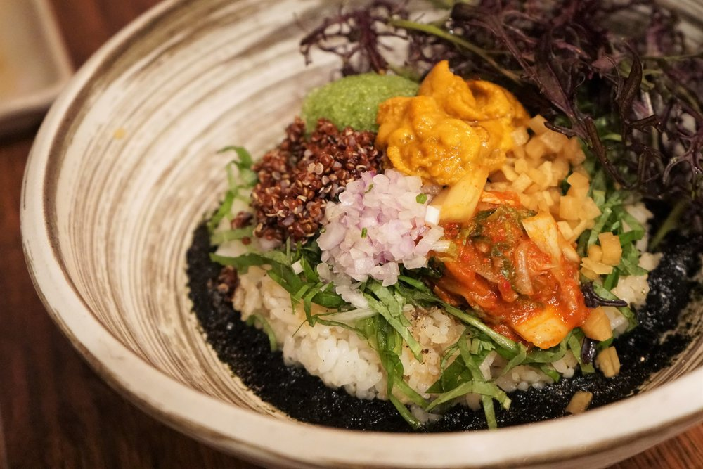 Uni Bibimbap with Quinoa, Rice, Kimchi, Soy Pickle, Perilla, Seaweed Puree, Baby Greens at Osamil in New York City