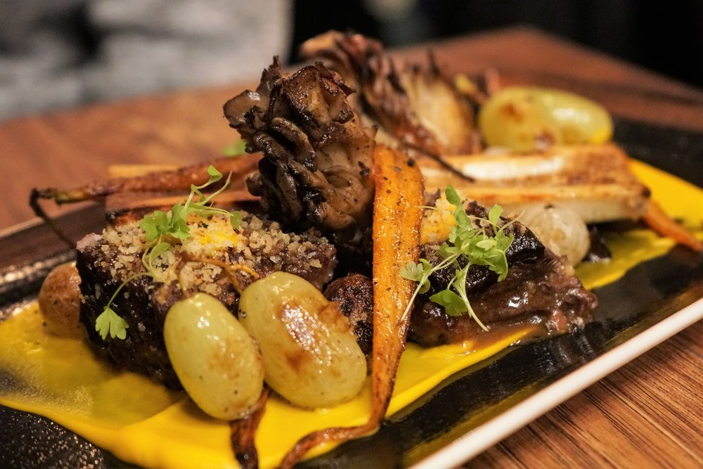 Braised Short Ribs - 6-hour Braised Beef Short Ribs, Kabocha, Bone Marrow, Charred Onion, Carrot, Grape, Cauliflower Bread Crumbs at Osamil in New York City