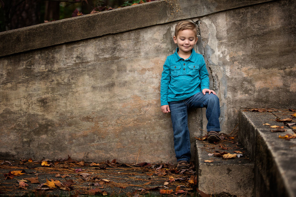small boy on concrete stairs.jpg