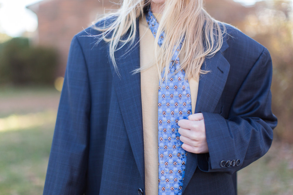 young girl in suit
