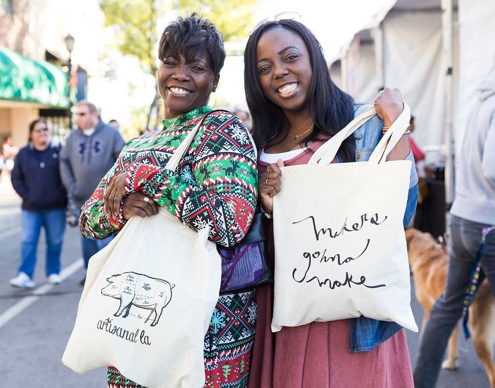 two-women-showing-off-their-makers-gonna-make-bags-shop-artisanal