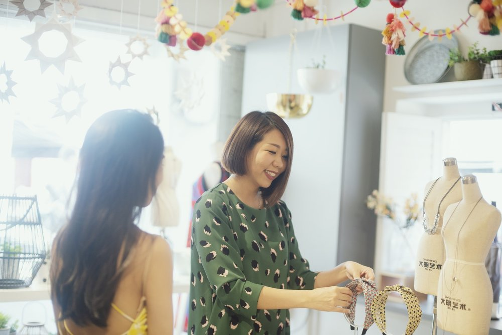 buyers-and-retailers-wholesale-woman-showing-sewn-goods