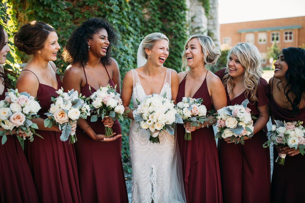 Bride and bridesmaids, Maroon bridesmaid dresses, fun wedding party photos, Wedding party group photos,