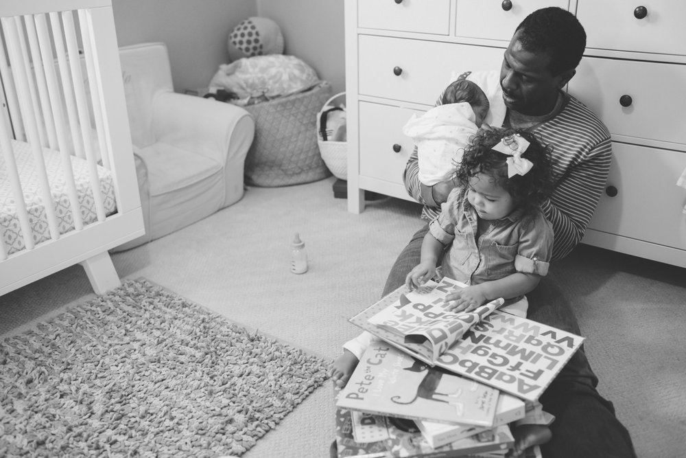 Dad's and their kids, Dads reading books, lifestyle family photographer
