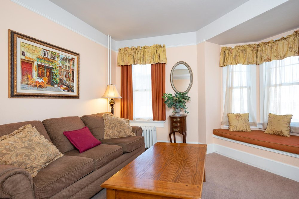 Premium Suite - At least 220 square feet. Bedroom with queen bed and separate sitting room with double sofa bed. Bathroom with walk in shower and a claw foot . Sleeps 4 guests and up to 2 children. Complimentary wifi and continental breakfast.