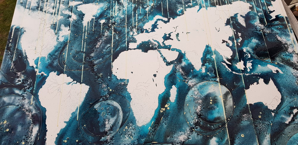 I have now added the oceans, I have used Maldon sea salt to indicate the fault lines along tectonic plates. I have tried to indicate the deep water trenches with darker pigments and lighter pigment for the qwarmer and shallower bodies of water. When dry I will remove the masking fluid that indicates the ocean currents.